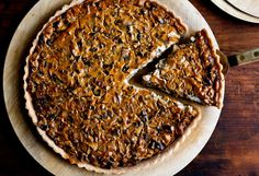 Tofu Mushroom Quiche // NY Times // This is a vegan quiche filled with a savory mix of blended tofu and mushrooms It has a deep, rich umami flavor No eggs are necessary to bind it; the tofu stiffens up when it bakes.