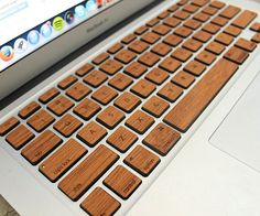 Give your high tech laptop a rustic appearance that'll turn heads by using this wood MacBook keyboard. Made with real mahogany veneer, each key features a pressure sensitive adhesive backing that makes installation remarkably easy.