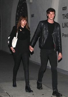 Dakota Johnson held hands with her rocker boyfriend Matthew Hitt on a date to Hollywood hotspot The Pikey Tuesday night
