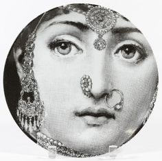 """Lot 261: Piero Fornasetti """"Lina in Indian Jewelry"""" Plate; Produced in Italy, numbered 228, stamped marks to the underside"""
