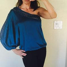 Very Sexy and Pretty Off-The Shoulder Top Never worn. Gorgeous on has intricate detail with gold thread along neckline and down the sleeve. This top is a small but fits more like a small/ medium. bebe Tops