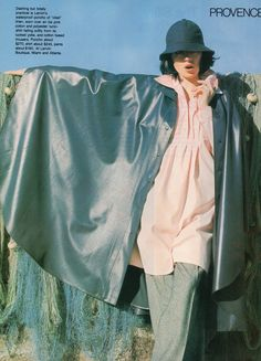 Lanvin- 1977 Waterproof blue poncho over a pink blouse and cotton tweed pants. L'officiel USA Spring 1977