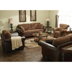 This brown sofa suite brings a neutral look to your living space. With bonded leather/fabric and a mahogany finish, this set is sure to be a unique piece in your home.