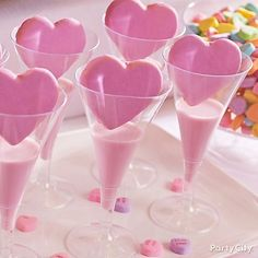 Pour glasses of strawberry milk in plastic wine glasses and place a pink heart sugar cookie on top. This milk and cookies pairing is for all ages!