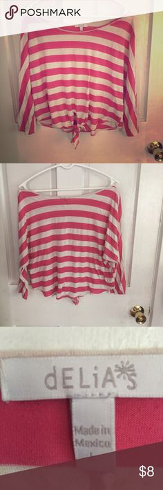 Delias pink striped 3/4 sleeve crop top This cute shirt is perfect for summer or any season with a tank top underneath. It has a cute tie in the front with a stylish 3/4 sleeve. Unique shirt to freshen up your wardrobe! Delias Tops Crop Tops