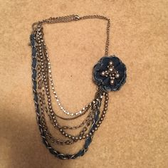 """""""Denim"""" and silver-plated necklace Necklace included seven different types of silver-plated chains, with a denim and silver beaded flower decoration. New and never worn, but no tags.  From a nonsmoking house. Jewelry Necklaces"""