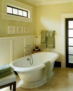 master bathroom :: tub, floor (tile color), transom window for over the toilet.