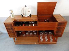 German made console stereo converted to a bar.  It came with the original 1966 sales slip.