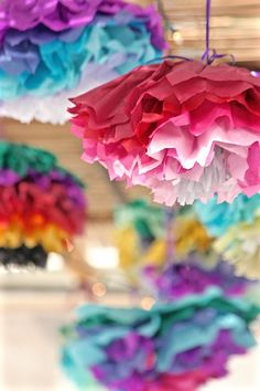 Paper flower sukkah decorations make a stunning statement in this sukkah inspired by Chihuly's Bellagio Hotel ceiling.