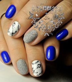Anchor Inspired Glittery, Blue Nail Art Design. You can create this adorable nail art design with the alternate nail colors. the anchors over the white base will make your jeans go more classy.