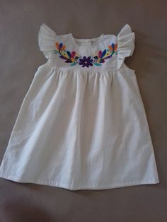 Dress for girl, with Otomi embroidery from Tenango.