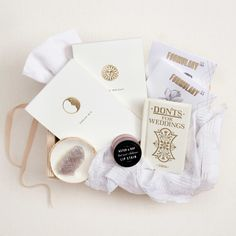 The perfect gift for your favorite girl on her very special day, the Bride-to-Be box is all about romance, charm, dreams come true, and memories made. Luxurious essentials with gilded details and keepsake treasures with whimsical flare provide everything she'll need to set intentions for her wedding day and beyond.