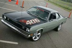 '70 Plymouth Duster. This is similar to my first car minus the numbers and hood decoration. Mine had a complete vinyl top