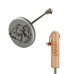 """Gonzaga University Bulldogs BBQ Branding Iron by Texas Irons. $39.95. Make your mark (and show your pride) with this unique BBQ Branding Iron. Perfect for steaks, burgers, chicken or just about anything you can grill. Durable stainless steel shaft with wood handle can endure intense grilling heat. Measures 14"""" long; Brand tip measures 3"""" in diameter. Show your team spirit with this handy barbeque tailgate tool, and leave your mark on just about anything! Featuring s..."""