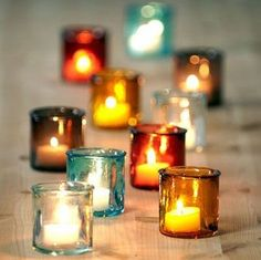 Make a bold statement by using these stunning colored glass votive holders as a table runner.Really love the simplicity in this.if we could only find the correct colors! and not on every table! Teal Fall Wedding, Winter Wedding Flowers, October Wedding, Whimsical Wedding, Trendy Wedding, Spring Wedding, Rustic Wedding, Simple Wedding Centerpieces, Fall Wedding Decorations