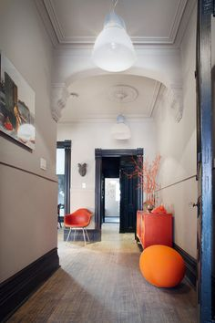 Black woodward, white walls, architectural details, bold color, modern lighting