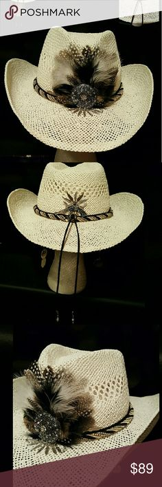White Feathered Cowgirl Hat Decked with a black and white satin rope band, a black leather lace band, exotic feathers, a crystal and rhinestone-studded medallion and 7 silver-tone feathers on the front. Hat is finished with gun, boots, bullets and feathers on the back. Leather lace extends approximately 9 inches. White Hat includes inside adjustable head band.  See matching Earrings. Accessories Hats