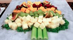Holiday cheese board in shape of a tree