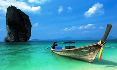 """The Andaman Sea and the Gulf of Thailand, in the South of Thailand are famous for the use of the, often brightly coloured, wooden long-tail boats. Westerners often refer to them as a water taxi. In the Thai language, these boats are called """"Ruea Hang Yao"""". http://islandinfokohsamui.com/"""