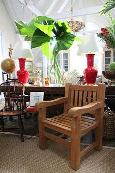 ecorate with an outdoor feel with this wooden slatted #arm #chair, greenery and bright red #Spitzmiller #lamps at #Southampton #Mecox #interiordesign #Hamptons #MecoxGardens #furniture #shopping #home #decor #design #room #designidea #vintage #antiques #garden