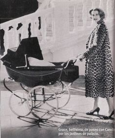 Princess Grace, in her leopard coat, walking with Princess Caroline in her carriage