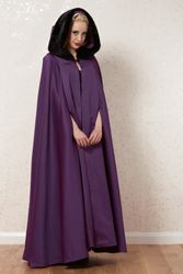 Satin cloak with faux fur hood.