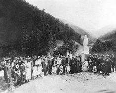 "Friends and family gather at Sarah Ann, WV for the dedication of the Italian marble statue of ""Devil Anse"" (Anderson) Hatfield which marks his grave. Mid - 1920's."