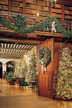 Christmas at Biltmore House in Ashville, North Carolina. Tall trees line the halls of the Tapestry Gallery. As guests enter the Library a warm glow from the rooms large fireplace is cast upon the bookshelves and the Pellegrini ceiling canvas. Christmas Lights, Christmas Decorations, Holiday Decor, Christmas Dance, Holiday Trip, Christmas Fireplace, Christmas Trees, Merry Christmas, Biltmore Estate Christmas