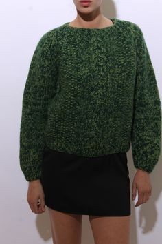 This vintage 1960s sweater is made of cozy, heavyweight wool in dark greens.  #1960s #vintagesweater #btmvintage Shop now at: www.btmvintage.com