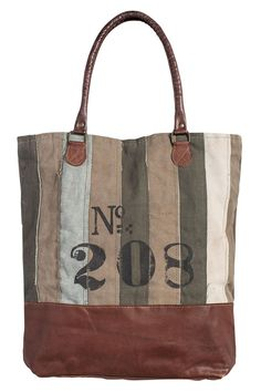 """The No. 208 tote has an assortment of colored stripes of beige and olive adding to the uniqueness of this bag. With No. 208 stenciled on the front of this earth-friendly tote it's the perfect size for air travel a weekend getaway enjoying the beach and even carrying a light-weight laptop.  Size: 17"""" W x 17"""" H x 4"""" D 