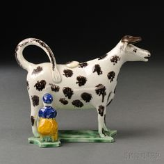 Staffordshire Earthenware Cow Creamer with Milkmaid | Sale Number 2663B, Lot Number 1106 | Skinner Auctioneers $800