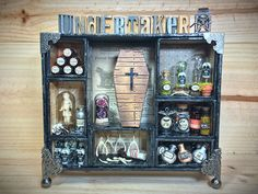 conjure up the creative spirits with this dimensional shadowbox from igirlzoe. this detailed assemblage takes your curiosities into the undertakers parlor filled with apothecary vials, domes of sk… Halloween Shadow Box, Christmas Shadow Boxes, Halloween Signs, Halloween Projects, Holidays Halloween, Christmas Art, Halloween Crafts, Halloween Decorations, Halloween Bottles