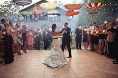 I love the upside down umbrellas used for decoration at this outdoor wedding. It's so... whimsical!