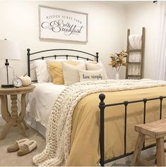 Any yellow fans out there? We're loving the soft mustard shade that put into her guest room! Plus, that wall art… Guest Bedroom Decor, Room Ideas Bedroom, Home Bedroom, Guest Room Bedding Ideas, Cottage Bedroom Decor, Ideas For Guest Bedroom, Small Guest Bedrooms, Cottage Style Bedrooms, Farm Bedroom