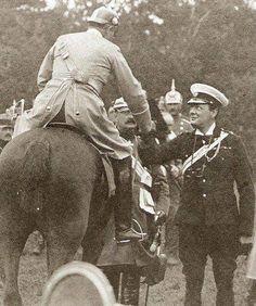 Winston Churchill and Kaiser Wilhelm II shake hands in 1909.