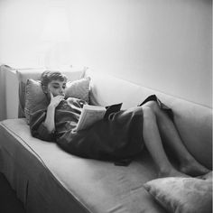 Audrey Hepburn reading a book on We Heart It