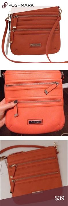 Calvin Klein Orange Crossbody Calvin Klein Burnt Orange Leather Crossbody Messenger Handbag. Never been used, perfect condition! Calvin Klein Bags Crossbody Bags