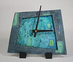 A collection of ceramic fasience Art Deco clocks from the Clockarium Museum ...