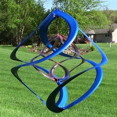 """Colored 14"""" Double Wind Spinner.  This wind spinner has the colored outer spinner with the beautiful copper coated smaller spinner inside that spins in the opposite direction. Choose from Green, Red, Purple or Blue to bring vibrant color to your outdoor or indoor living spaces.  Watch the video on our website for a demonstration!  #windspinner #windspinners"""