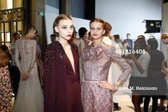 News Photo : Models pose backstage after the Georges Hobeika