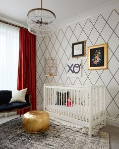 SuzAnn Kletzien - Black and white girl's nursery features walls clad in black and white trellis wallpaper, Dedar Sassy Bianco Nero Wallpaper, lined with an art collection over a white crib accented with pink dot bedding and a black and white ruffle crib skirt illuminated by a gold cage floor lamp, Stray Dog Designs Grady Floor Lamp and a PB Teen La Boheme Crystal Chandelier.