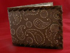 Embossed and sanded wallet card with ribbon laced around edges.