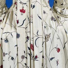 Detail rear view, India for the Western market, robe à la francaise, c. 1780. White cotton chintz embroidered with thin flower stems (Indian export embroidery).