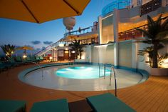 The 'Serenity pool' on board the new Carnival Sunshine.  Three levels, a waterfall AND adults only!  We can help you book your passage at www.elotravel.com.