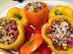 Stuffed Sweet Peppers: makes 3 peppers: sauté minced garlic, chopped onion, chopped mushrooms in little coconut oil with paprika, salt, pepper and oregano on med heat for 5-7 min. Add 1/2C veggie broth, increase heat to high. When boiling add 1/4C Quinoa. Cover and simmer low for 15 min. Preheat oven to 400, cut tops off peppers and remove seeds and the ridges along inside. Place in greased baking dish so they will sit snug & not fall. When quinoa done, mix in half can kidney or black beans…