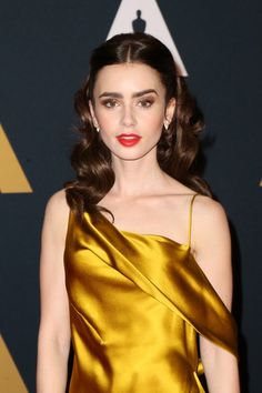 Lily Collins Photos Photos - Actress Lily Collins attends the Academy of Motion Picture Arts and Sciences' 8th annual Governors Awards at The Ray Dolby Ballroom at Hollywood & Highland Center on November 12, 2016 in Hollywood, California. - Academy Of Mot