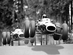 Jackie Stewart (front) and teammate Graham Hill (rear) airborne through Pflanzgarten at the Nürburgring in 1965.