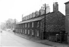 Black and white photograph showing either White Row or Gaugers Row, Ravenhead, MSE - The Frank Sheen Collection 2 - Photographs showing various buildings, events and housing in St. 3 - Photographs showing various streets and housing in St. St Helens Town, Saint Helens, Family Album, My Town, The Row, Past, Black And White, Street, Buildings