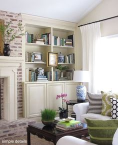 By pairing the sweet cream color of built-in bookshelves with a white-washed brick fireplace \/simpledetails\/ has effortlessly created a french country style that is elegant and chic. Finish the look with cobalt blue china for a pop of color!