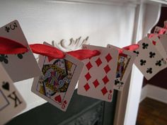 Playing card garland. Author recommends using giant cards.